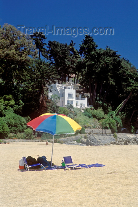 chile184: Zapallar, Valparaíso region, Chile: the coastal play ground of wealthy Chileans has a beautiful beach and exclusive homes - parasol - photo by C.Lovell - (c) Travel-Images.com - Stock Photography agency - Image Bank