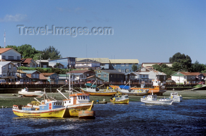 chile190: Quellón, Chiloé island, Los Lagos Region, Chile: the fishing village seen from the Navimag Ferry Alejandrina on arrival from Chaitén to Chiloe Island – fishing boats and waterfront houses – Costanera Pedro Montt – Canal Yelcho - photo by C.Lovell - (c) Travel-Images.com - Stock Photography agency - Image Bank