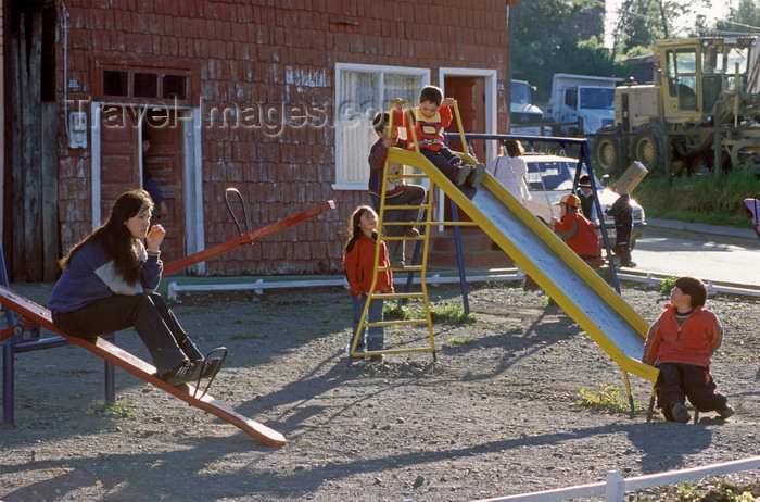 chile198: Chonchi, Chiloé island, Los Lagos Region, Chile: children play on a slide - house with roof shingle covered walls - photo by C.Lovell - (c) Travel-Images.com - Stock Photography agency - Image Bank