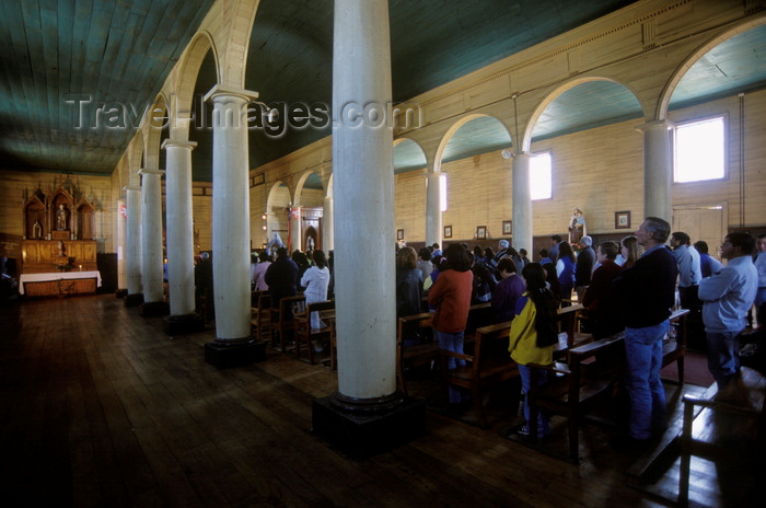 chile202: Dalcahue, Chiloé island, Los Lagos Region, Chile: interior with worshipers of the neoclassical 19th century church - Doric columns - Patrimonio de la Humanidad - photo by C.Lovell - (c) Travel-Images.com - Stock Photography agency - Image Bank