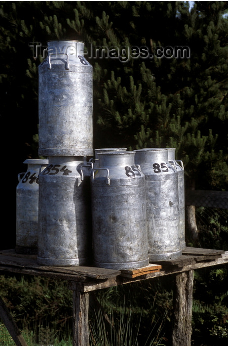 chile207: Chiloé island, Los Lagos Region, Chile: milk cans await pick up on a country - dairy industry - photo by C.Lovell - (c) Travel-Images.com - Stock Photography agency - Image Bank