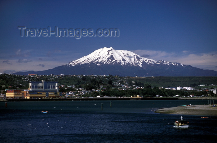 chile210: Puerto Montt, Llanquihue Province, Los Lagos Region, Chile: view of Puerto Montt with a snow-capped Andean peak behind the city - photo by C.Lovell - (c) Travel-Images.com - Stock Photography agency - Image Bank