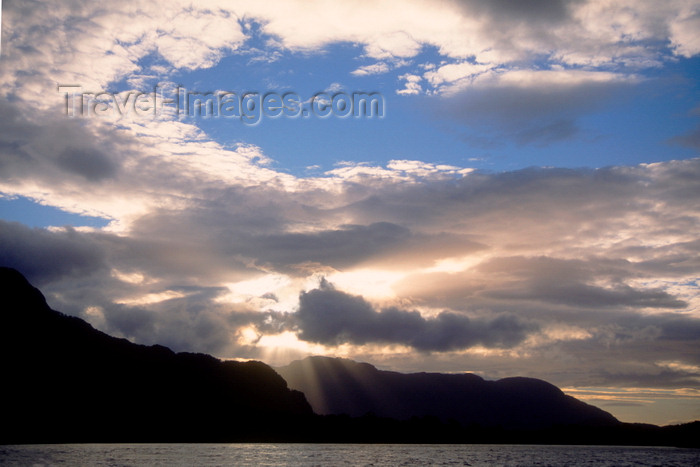 chile217: Aisén region, Chile: clouds and rays of light - temperate rain forest of northern Patagonia and the Pacific Ocean - photo by C.Lovell - (c) Travel-Images.com - Stock Photography agency - Image Bank