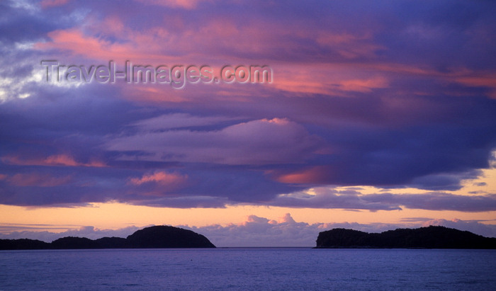 chile220: Aisén region, Chile: island silhouettes and the Pacific Ocean at sunset- photo by C.Lovell - (c) Travel-Images.com - Stock Photography agency - Image Bank