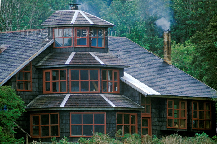 chile225: Anihue Bay, Aisén region, Chile: wooden home with walls covered in wooden shingles – smoking chimney - temperate rain forest in northern Patagonia west of La Junta - photo by C.Lovell - (c) Travel-Images.com - Stock Photography agency - Image Bank