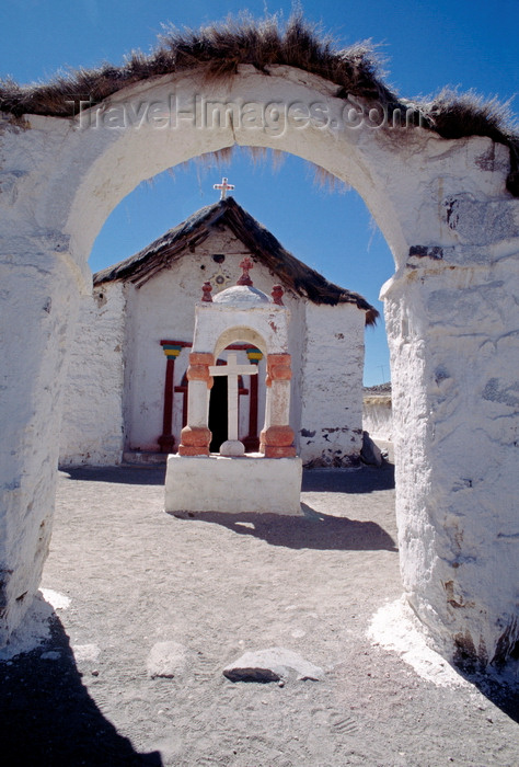 chile241: Lauca National Park, Arica and Parinacota region, Chile: beautiful 17th century adobe church in the village of Parinacota - whitewashed entrance arch - Norte Grande - photo by C.Lovell - (c) Travel-Images.com - Stock Photography agency - Image Bank