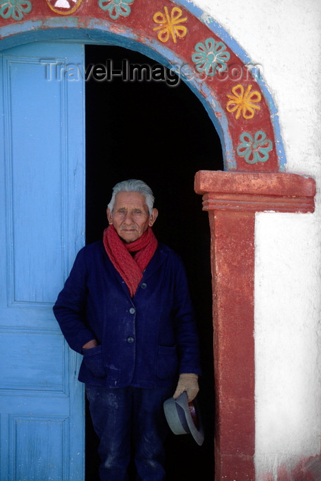 chile243: Lauca National Park, Arica and Parinacota region, Chile: Aymara grounds keeper of the 17th century adobe church in the village of Parinacota - Norte Grande - photo by C.Lovell - (c) Travel-Images.com - Stock Photography agency - Image Bank