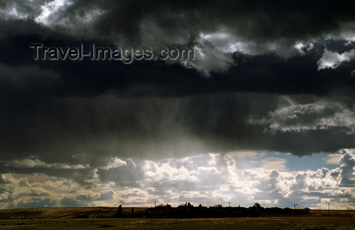 chile254: Magallanes region, Chile: storm clouds over an estancia on the pampas of Patagonia – estancias are extensive agricultural properties dedicated to cattle or sheep grazing – biological free range meat production - photo by C.Lovell - (c) Travel-Images.com - Stock Photography agency - Image Bank