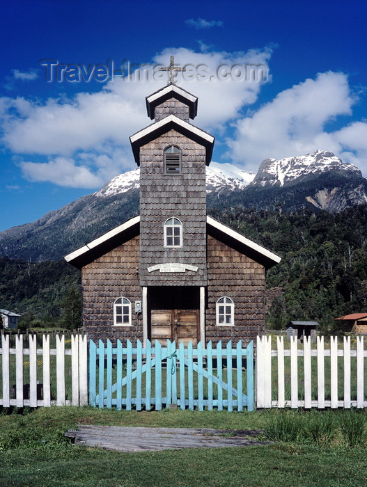 chile279: Aisén region, Chile: wooden church with white picket fence and blue gate on the camino austral – wooden shingles - Patagonia - photo by C.Lovell - (c) Travel-Images.com - Stock Photography agency - Image Bank