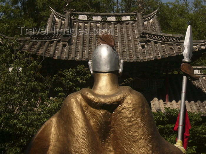 china234: Lijiang, Yunnan Province, China: Dragon Park - golden warrior and traditional roof - photo by M.Samper - (c) Travel-Images.com - Stock Photography agency - Image Bank