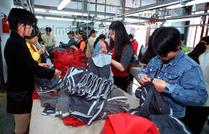 china242: Dongguan, Guangdong province, China: seamstress - Chinese factory workers - photo by B.Henry - (c) Travel-Images.com - Stock Photography agency - Image Bank