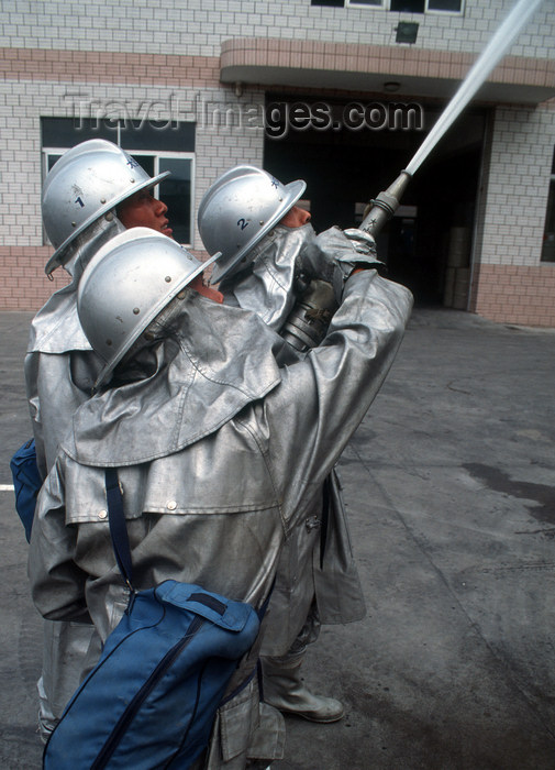 china244: Dongguan, Guangdong province, China: Chinese firemen - with hose - photo by B.Henry - (c) Travel-Images.com - Stock Photography agency - Image Bank