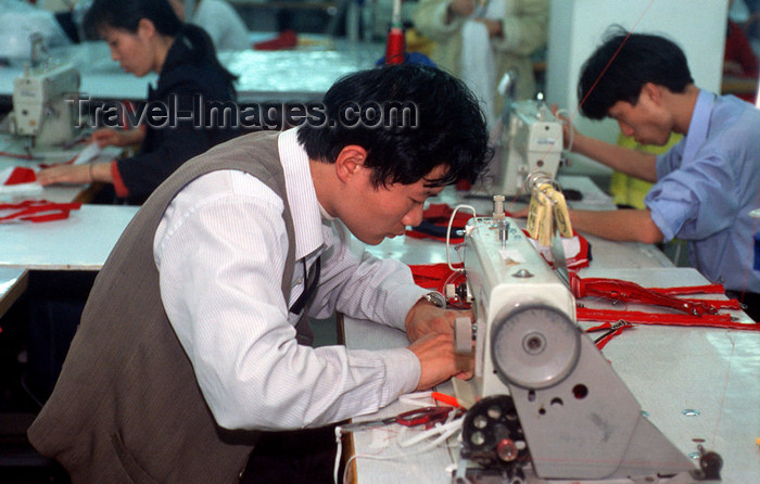 china248: Dongguan, Guangdong province, China: seamster using a sewing machine - Chinese factory worker - photo by B.Henry - (c) Travel-Images.com - Stock Photography agency - Image Bank