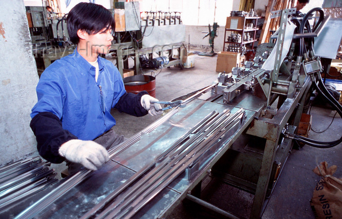 china254: Dongguan, Guangdong province, China: metal worker - Chinese factory - photo by B.Henry - (c) Travel-Images.com - Stock Photography agency - Image Bank