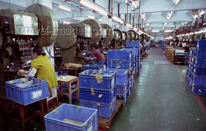 china255: Dongguan, Guangdong province, China: Chinese factory workers - line of machines - photo by B.Henry - (c) Travel-Images.com - Stock Photography agency - Image Bank