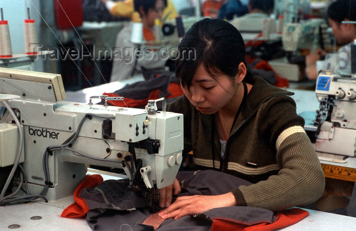 china259: Dongguan, Guangdong province, China: seamstress using a sewing machine - Chinese factory worker - photo by B.Henry - (c) Travel-Images.com - Stock Photography agency - Image Bank
