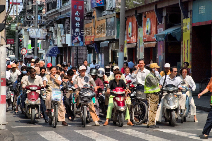 china262: Shanghai, China: crowd of bicycles and motorbikes at a traffic light - photo by Y.Xu - (c) Travel-Images.com - Stock Photography agency - Image Bank