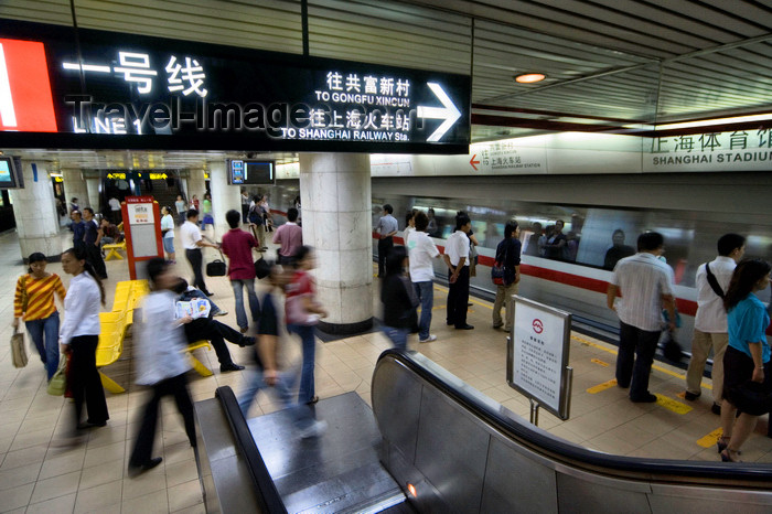 china272: Shanghai, China: subway - Stadium station - escalator and train arriving - photo by Y.Xu - (c) Travel-Images.com - Stock Photography agency - Image Bank