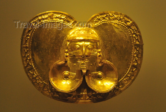 colombia155: Bogotá, Colombia: Gold Museum - Museo del Oro - Yotoco pectoral, hieratic face as the central motif, adorned with large nose and ear ornaments - embossing technique - Calima region - photo by M.Torres - (c) Travel-Images.com - Stock Photography agency - Image Bank