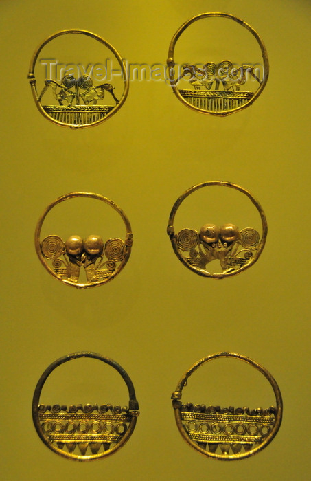 colombia168: Bogotá, Colombia: Gold Museum - Museo del Oro - tumbaga earrings - Zenú filigree work - dignitaries and amphibian men - photo by M.Torres - (c) Travel-Images.com - Stock Photography agency - Image Bank