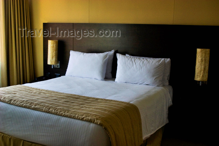 colombia19: Medellín, Colombia: a comfortable hotel bed awaiting a guest's rest - photo by E.Estrada - (c) Travel-Images.com - Stock Photography agency - Image Bank