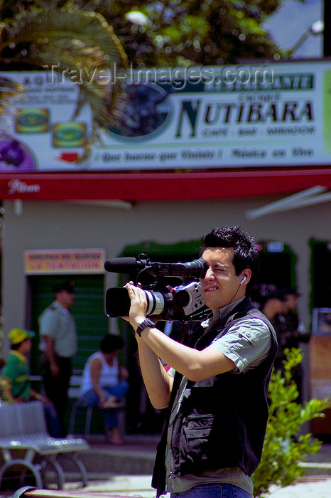 colombia25: Medellín, Colombia: camera operator at work near restaurante Nutibara - photo by E.Estrada - (c) Travel-Images.com - Stock Photography agency - Image Bank