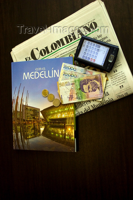 colombia28: Medellín, Colombia: a traveller's accessories - Meddllín guide, PDA, Colombian Pesos, El Colombiano newspaper - photo by E.Estrada - (c) Travel-Images.com - Stock Photography agency - Image Bank
