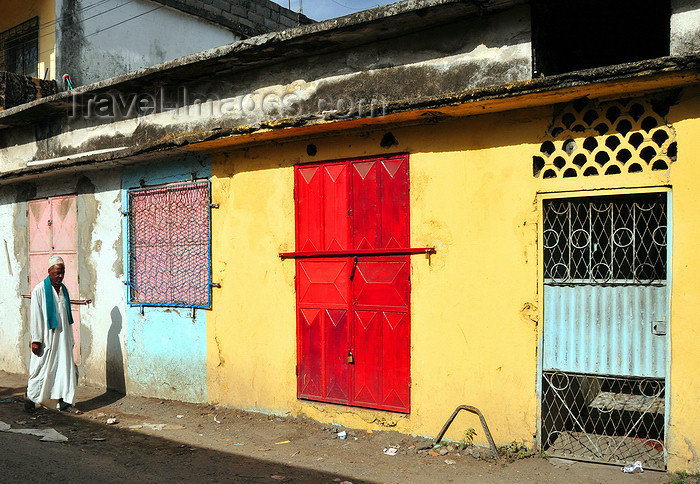 comoros65: Moroni, Grande Comore / Ngazidja, Comoros islands: colourful façade and man wearing a kanzu white robe - photo by M.Torres - (c) Travel-Images.com - Stock Photography agency - Image Bank