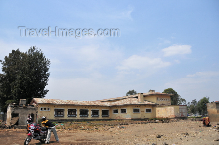 congo-dr21: Goma, Nord-Kivu, Democratic Republic of the Congo: biker in front of an old colonial school building - photo by M.Torres - (c) Travel-Images.com - Stock Photography agency - Image Bank