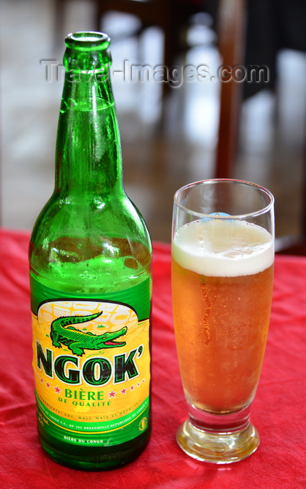 congo42: Brazzaville, Congo: Ngok' beer - bottle and glass of the famous Congolese brew - photo by M.Torres - (c) Travel-Images.com - Stock Photography agency - Image Bank
