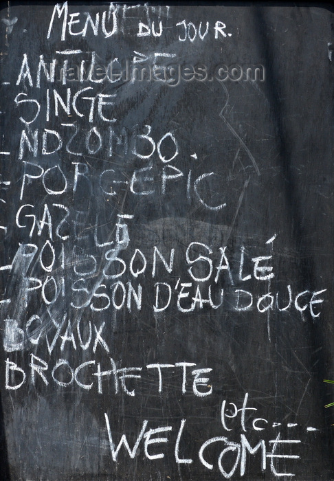 congo53: Brazzaville, Congo: wildlife for lunch - bush meat advertised in a blackboard outside a restaurant - among other specialities you can have antelope, monkey, gazelle, porcupine, lungfish (ndzombo) ... - photo by M.Torres - (c) Travel-Images.com - Stock Photography agency - Image Bank