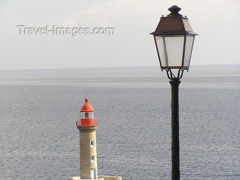 corsica171: Corsica - Bastia: lighthouse and lamppost - photo by J.Kaman - (c) Travel-Images.com - Stock Photography agency - Image Bank