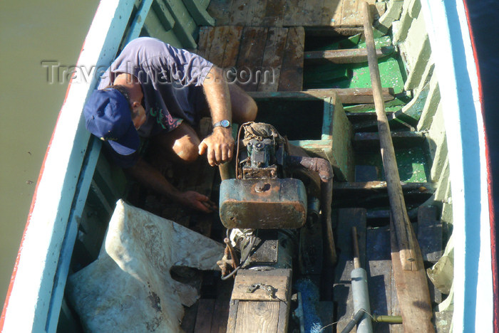 cuba40: Cuba - Guardalavaca - fixing a boat engine - photo by G.Friedman - (c) Travel-Images.com - Stock Photography agency - Image Bank