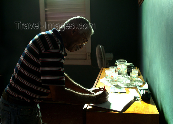 cuba43: Cuba - Guardalavaca - man writes a thoughtful letter in the late afternoon - Emilio - photo by G.Friedman - (c) Travel-Images.com - Stock Photography agency - Image Bank