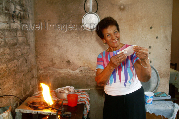 cuba48: Cuba - Guardalavaca - shy aunt cooking fish - photo by G.Friedman - (c) Travel-Images.com - Stock Photography agency - Image Bank