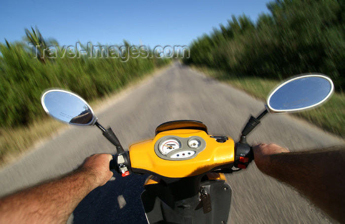 cuba57: Cuba - Guardalavaca - yellow scooter - the open road - photo by G.Friedman - (c) Travel-Images.com - Stock Photography agency - Image Bank