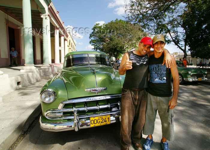 cuba69: Cuba - Holguín - Green Chevy and young owners  - photo by G.Friedman - (c) Travel-Images.com - Stock Photography agency - Image Bank