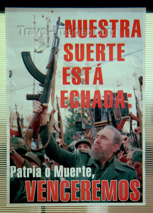 cuba77: Cuba - Holguín - political poster - Fidel with AK-77 - 'Fatherland or Death - We shall win' - photo by G.Friedman - (c) Travel-Images.com - Stock Photography agency - Image Bank