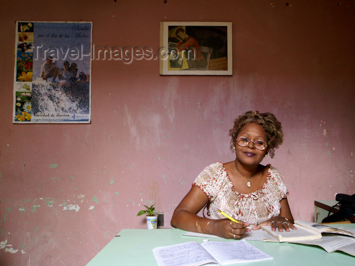 cuba79: Cuba - Holguín - secretary and red wall - an office worker studies at her desk - photo by G.Friedman - (c) Travel-Images.com - Stock Photography agency - Image Bank