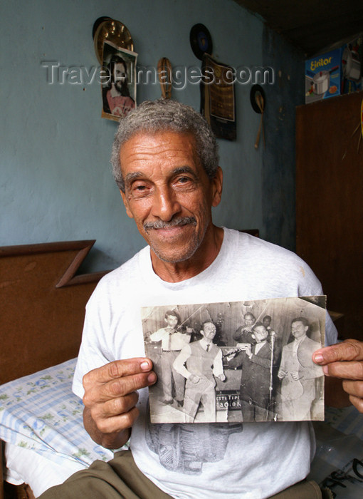cuba81: Cuba - Holguín - this musician proudly shows off a photo of him and his band in his glory days - Cuban Band Leader - photo by G.Friedman - (c) Travel-Images.com - Stock Photography agency - Image Bank