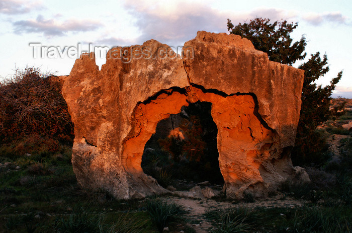 cyprus109: Paphos, Cyprus: red rock - sunset at the tomb of the kings - photo by A.Ferrari - (c) Travel-Images.com - Stock Photography agency - Image Bank