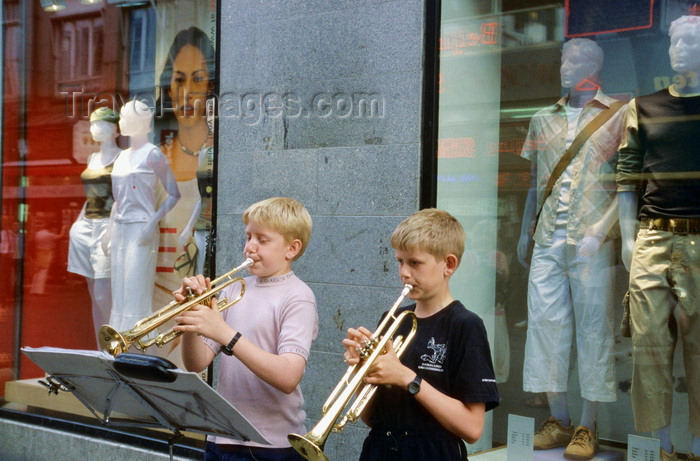 denmark15: Copenhagen, Denmark: two boys playing trumpets on the street - music stand with sheet music - clothes shop windows - photo by K.Gapys - (c) Travel-Images.com - Stock Photography agency - Image Bank