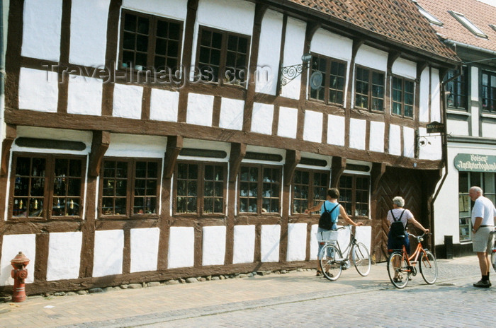 denmark32: Odense, Funen island, Syddanmark, Denmark: people walking their bikes in front of a timber structure building - photo by K.Gapys - (c) Travel-Images.com - Stock Photography agency - Image Bank