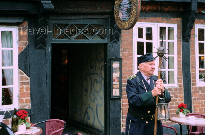 denmark37: Ribe, southwest Jutland, Denmark: guardian with medieval weapon standing in front of restaurant - spiked club called a 'morning star'