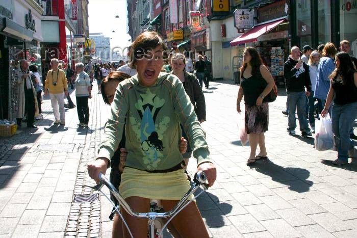 denmark49: Denmark - Copenhagen: scared biker in mini-skirt - photo by C.Blam - (c) Travel-Images.com - Stock Photography agency - Image Bank