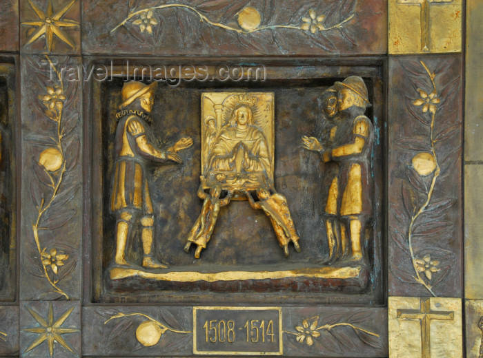 dominican109: Higüey, Dominican Republic: La Altagracia - the Virgin before the Sabana Battle - detail of the bronze gate of the Basilica of Our Lady - Basilica de Nuestra Señora de la Altagracia - alto relieve en bronce - photo by M.Torres - (c) Travel-Images.com - Stock Photography agency - Image Bank