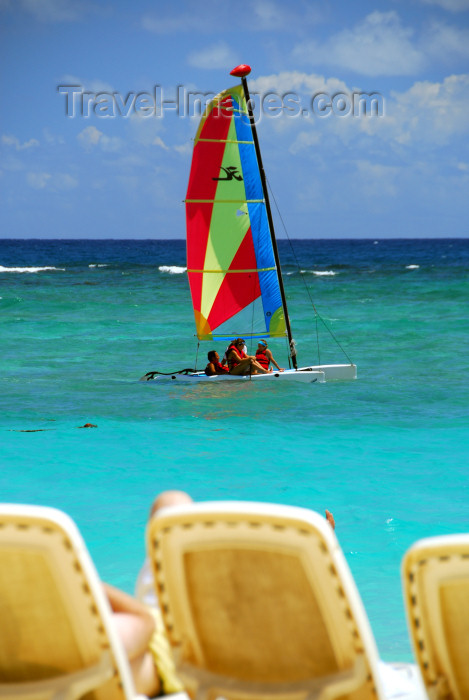 dominican159: Punta Cana, Dominican Republic: small catamaran - the chaise longue perspective -  Arena Gorda Beach - photo by M.Torres - (c) Travel-Images.com - Stock Photography agency - Image Bank