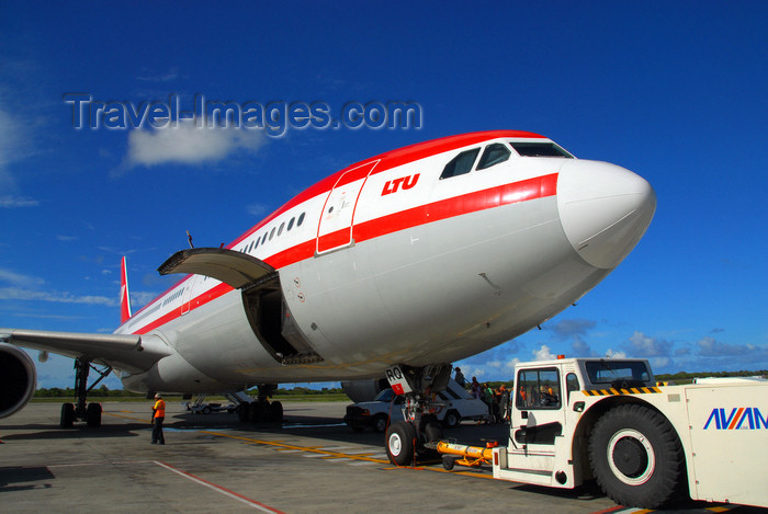 dominican189: Punta Cana, Dominican Republic: LTU Airbus A330-322 D-AERQ and Aircraft Tow Tractor with Towbar - Punta Cana International Airport - PUJ / MDPC - photo by M.Torres - (c) Travel-Images.com - Stock Photography agency - Image Bank