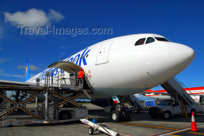 dominican190: Punta Cana, Dominican Republic: Thomas Cook Airlines Airbus A330-243 G-OJMC with cargo platform - Punta Cana International Airport - PUJ / MDPC - photo by M.Torres - (c) Travel-Images.com - Stock Photography agency - Image Bank