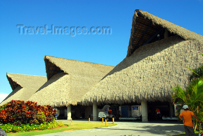 dominican191: Punta Cana, Dominican Republic: thatched roofs of terminal - air side - Punta Cana International Airport - PUJ / MDPC - photo by M.Torres - (c) Travel-Images.com - Stock Photography agency - Image Bank